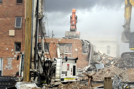 CIVIC paste ups cling on during the demolition. Photographer Lachlan Bence, Courier Newspaper